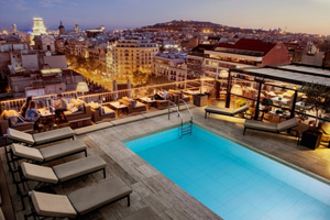 Rooftop, pool-side views of Barcelona are a must